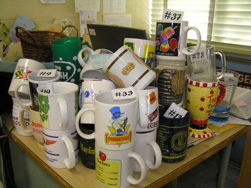 Thirty-seven craptatstic mugs! (Did I mention that I hate mugs?)