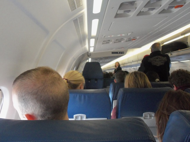 That thing blocking the view is a flight attendant's seat.  She sat there and faced a passenger.