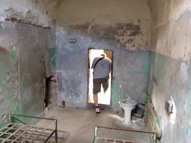This room was cleaned up a little because it is the site of an attempted escape.  See the hole in the wall to the left?