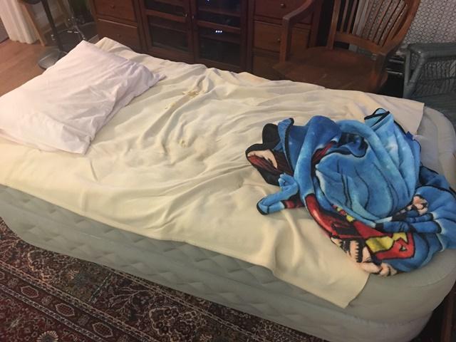 He's under the blanket.