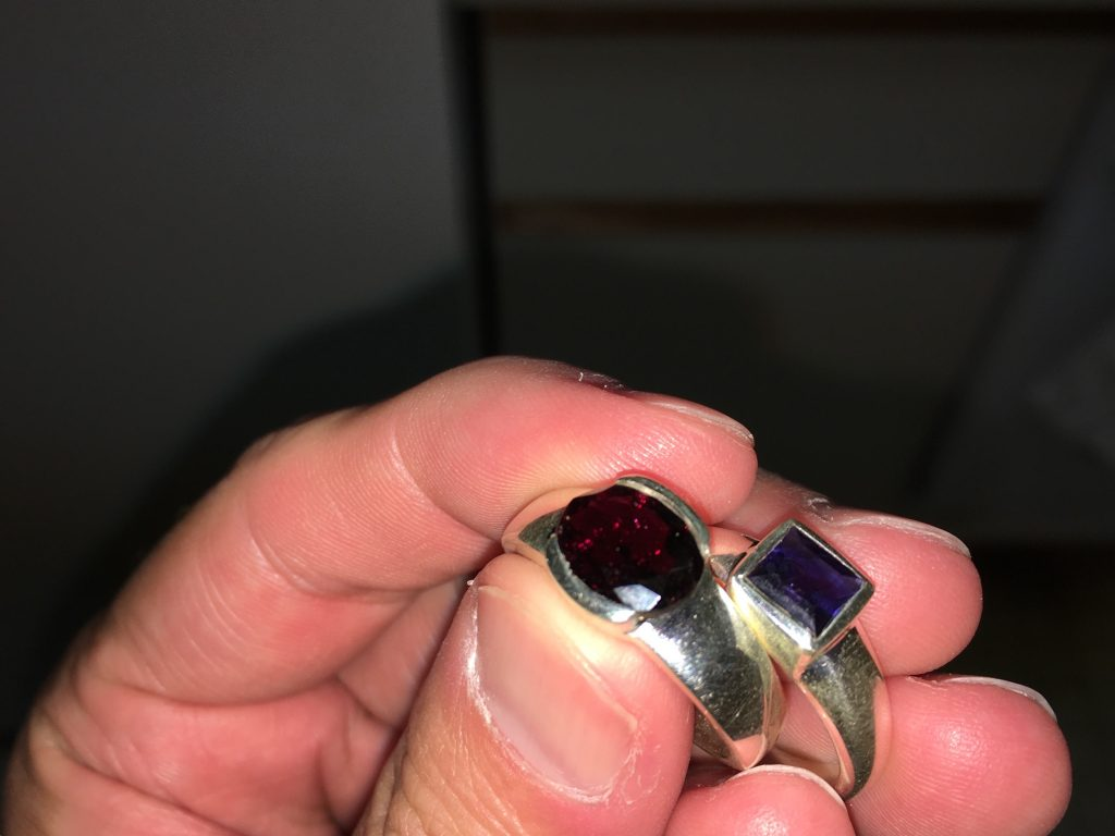 The garnet looks red, but the iolite looks more black than purple.