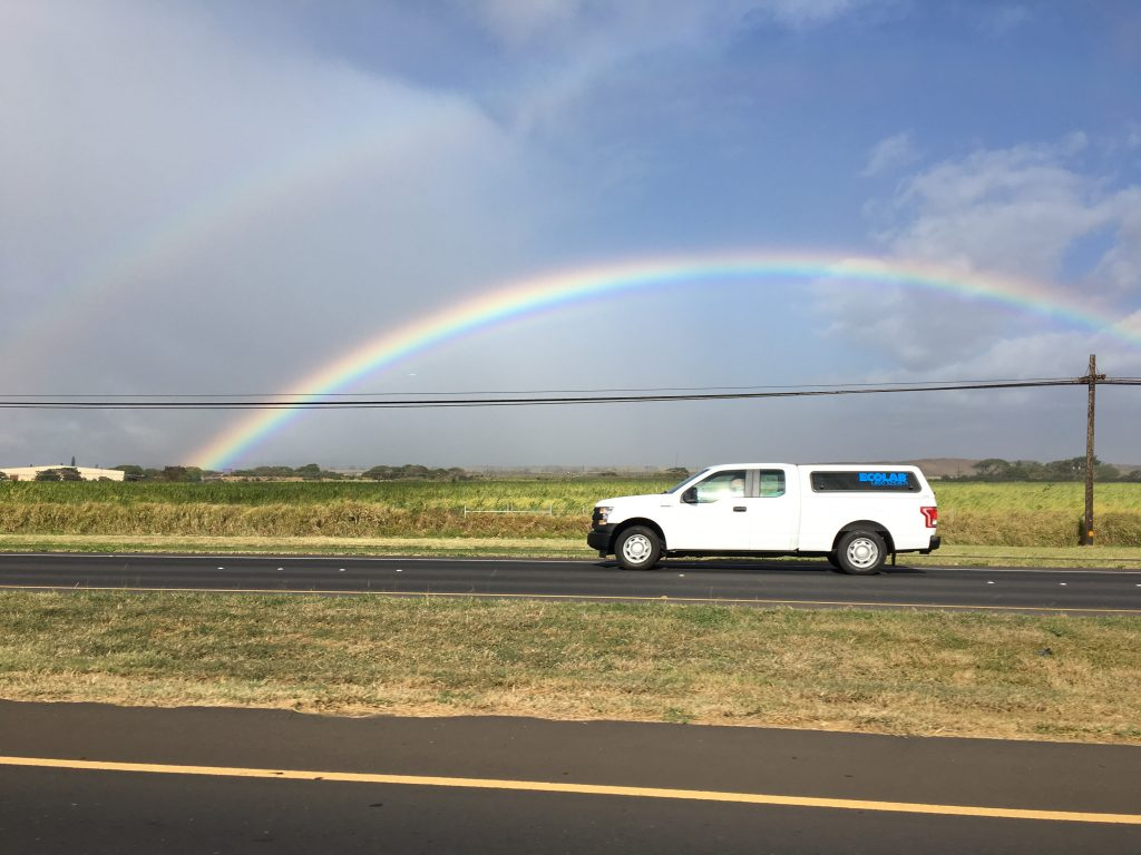The bottom edge of the rainbow had a small ribbon of repeated colors.  There was also a shadow of a double-rainbow.
