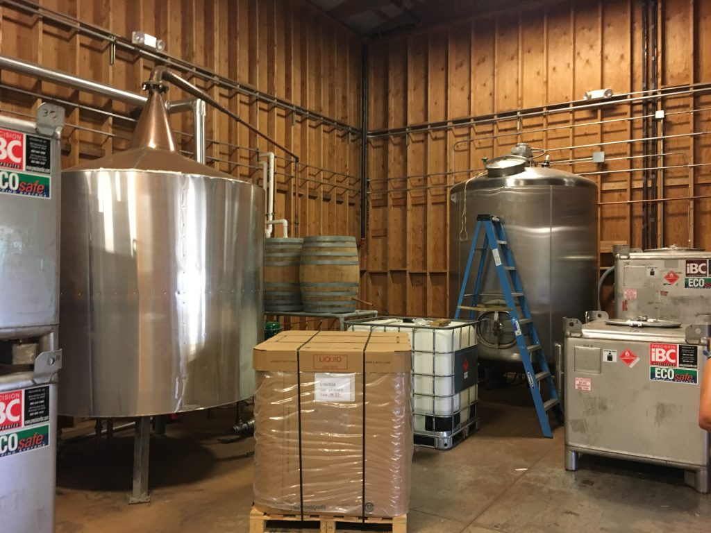 The two silver tanks are a still and a blending tank.